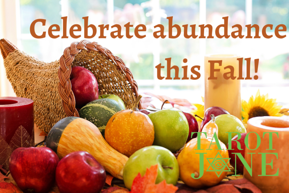 """A cornucopia spills it's harvest bounty onto a table with the words """"Celebrate your abundance this Fall!"""""""