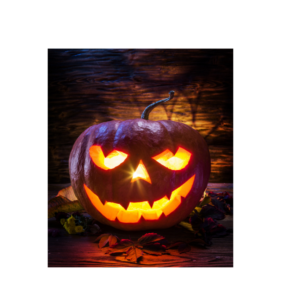 A carved pumpkin glows from within.